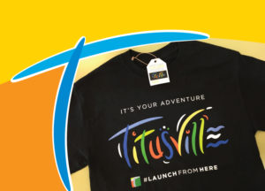Shirt with Titusville logo on it