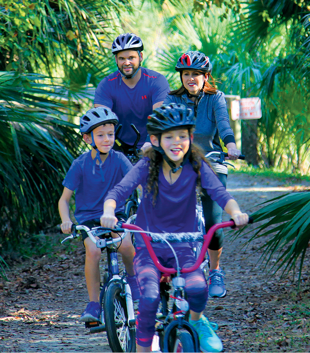 A family cycling along a park trail